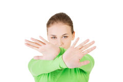 Młoda kobieta seansu przerwy znak z oba rękami obraz royalty free