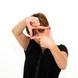 Młoda kobieta skupiającym się widok jest Fotografia Stock