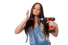Młoda kobieta trzyma cordless elektrycznego świder Zdjęcie Royalty Free