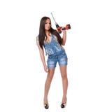 Młoda kobieta trzyma cordless elektrycznego świder Obraz Royalty Free