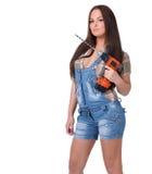 Młoda kobieta trzyma cordless elektrycznego świder Fotografia Stock