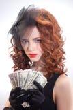 Młoda kobieta trzyma dolara pieniądze Fotografia Stock