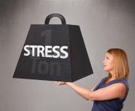 Młoda kobieta trzyma jeden tonę stresu ciężar Zdjęcie Stock