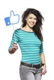 Młoda kobieta trzyma ogólnospołeczni środki podpisuje uśmiecha się Obrazy Royalty Free