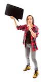Młoda kobieta trzyma pustego mowa bąbel z palcem na wargach Obraz Stock