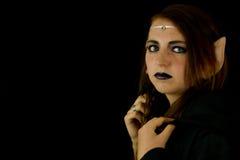 Młoda kobieta ubierająca jako elf Zdjęcia Stock