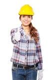 Młoda kobieta w budowa hełmie i czek koszula fotografia stock