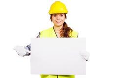 Młoda kobieta w budowa hełmie z nameplate fotografia royalty free