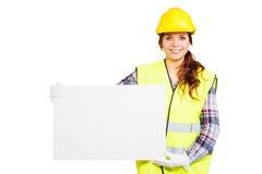 Młoda kobieta w budowa hełmie z nameplate zdjęcie royalty free