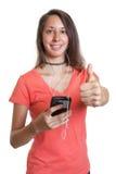 Młoda kobieta w czerwonej koszula lubi muzykę Zdjęcie Stock