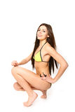Młoda kobieta w swimsuit na białym tle fotografia stock