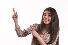 Młoda kobieta wskazuje palce daleko od obraz royalty free
