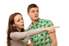 Młoda kobieta wskazuje z podnieceniem z jej ręką Fotografia Stock