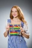 Młoda kobieta z abakusem w szkole Zdjęcia Stock