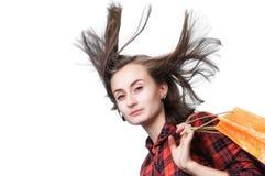 Młoda kobieta z długim podmuchowym włosy i shoping torbami Obraz Royalty Free