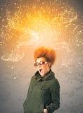 Młoda kobieta z energicznym wybucha czerwonym włosy Obrazy Royalty Free