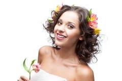 Młoda kobieta z kwiatem Zdjęcia Royalty Free