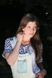 Młoda kobieta z lat dungarees i flancami podczas gdy łowiący Obrazy Stock