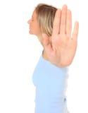 Młoda kobieta z odpędzenie gestem Zdjęcie Stock
