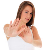 Młoda kobieta z odpędzenie gestem Zdjęcie Royalty Free