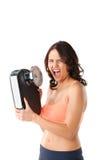 Młoda kobieta z pomiarową skala Zdjęcia Royalty Free