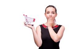 Młoda kobieta z wózek na zakupy odizolowywającym na bielu Obraz Stock