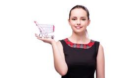 Młoda kobieta z wózek na zakupy odizolowywającym na bielu Zdjęcie Stock