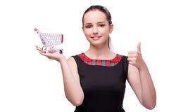 Młoda kobieta z wózek na zakupy odizolowywającym na bielu Zdjęcia Stock