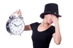 Młoda kobieta z zegarem zdjęcia stock