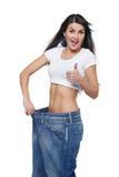Młoda kobieta zachwycająca z jej dieting rezultatami Obraz Stock