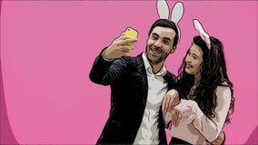 Młoda kochanek para na różowym tle Z głodnymi ucho na głowie Podczas ten Wielkanocnej fotografii, zrobiłem sephi na mój telefonie zbiory