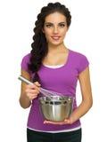 Młoda kulinarna kobieta odizolowywająca Fotografia Stock