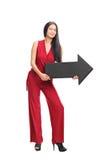 Młoda modna kobieta trzyma strzała zdjęcie stock