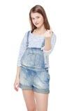 Młoda nastoletnia dziewczyna z skinąć gest odizolowywającego obrazy stock
