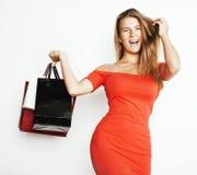 Młoda nowożytna blond kobieta z różnorodny toreb pozować emocjonalny na białym tle, sprzedaż, stylu życia pojęcia ludzie Obraz Royalty Free