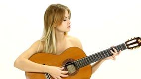 Młoda piękna caucasian kobieta w przypadkowy bawić się zdjęcie wideo