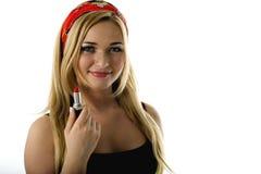 Młoda piękna kobieta pokazuje pomadkę Zdjęcia Royalty Free