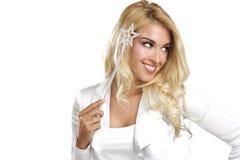 Młoda piękna kobieta trzyma magiczną różdżkę Zdjęcia Royalty Free