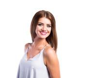 Młoda piękna kobieta w bielu wierzchołku, studio strzał, odizolowywający Zdjęcie Stock