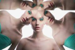 Młoda piękna kobieta z jaskrawym colorfull makeup odizolowywającym na białym tle obrazy stock