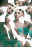 Młoda piękna kobieta z jaskrawym colorfull makeup odizolowywającym na białym tle fotografia stock