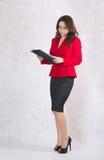 Młoda pomyślna biznesowa dama w klasycznym kostiumu Obraz Stock
