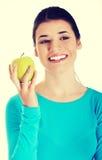 Młoda przypadkowa kobieta trzyma jabłka Zdjęcia Royalty Free