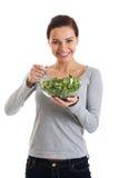 Młoda przypadkowa kobiety łasowania baranka sałata. Fotografia Royalty Free