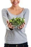 Młoda przypadkowa kobiety łasowania baranka sałata. Obraz Stock