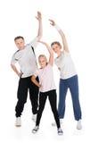 Młoda rodzinna robi sprawność fizyczna wpólnie Fotografia Stock