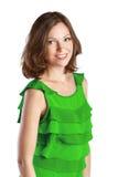Młoda rozochocona kobieta w zieleni sukni obraz stock