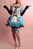 Młoda seksowna kobieta w erotyk sukni Alice w krainie cudów na różowym tle Obraz Stock