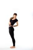 Młoda seksowna sportowa kobieta w czarnym sportswear długim - isol obraz royalty free