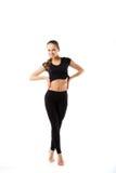 Młoda seksowna sportowa kobieta w czarnym sportswear długim - isol fotografia royalty free